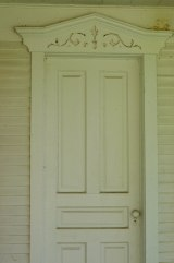 Door on west side of parlor.