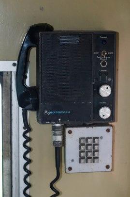 Telephone over desk for communication.