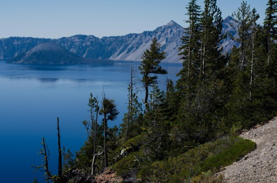This is Wizard Island. It is a volcanic crater rising 764 ft. (233 meters) above the water of Crater Lake. At the summit of Wizard Island is a crater 300 ft (90 meters) across.