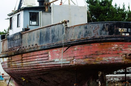 Wooden fishing boat that is dry-docked.