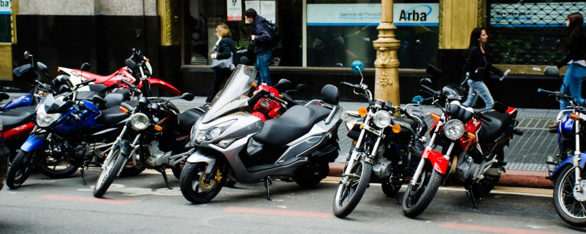 Motorcycles and cars seem to share the road.